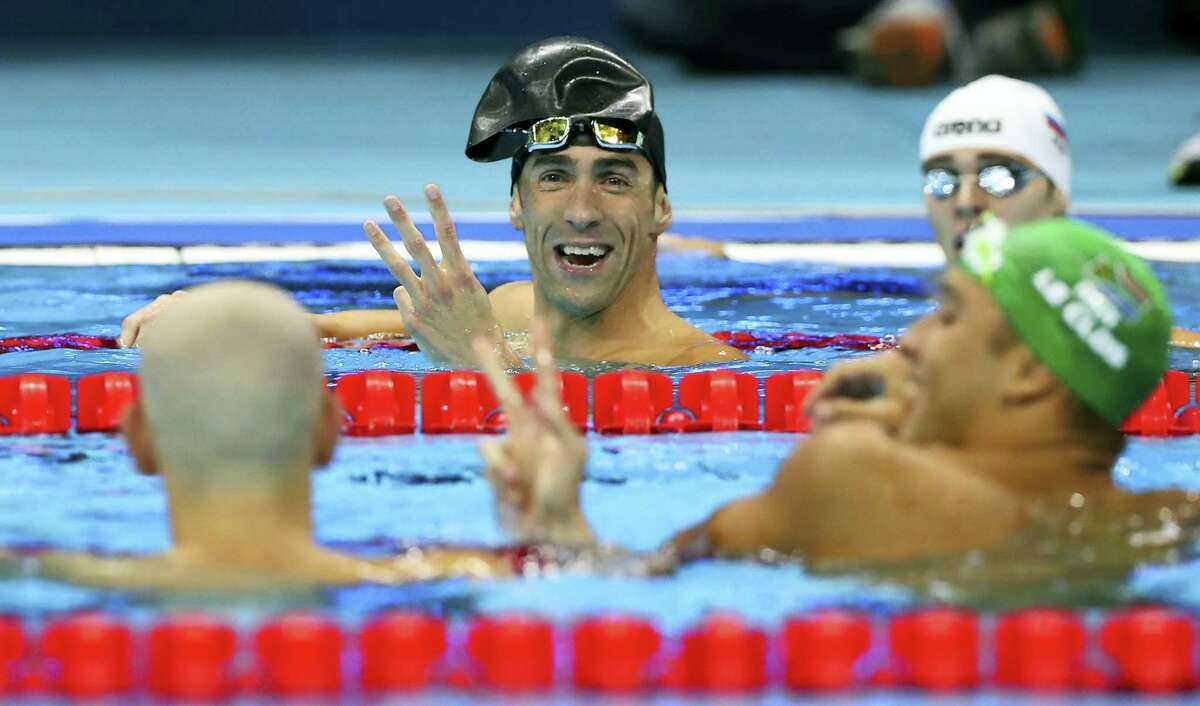 Michael Phelps, center, jokes with fellow silver medal winners Hungary's Laszlo Cseh, left, and South Africa's Chad Le Clos.