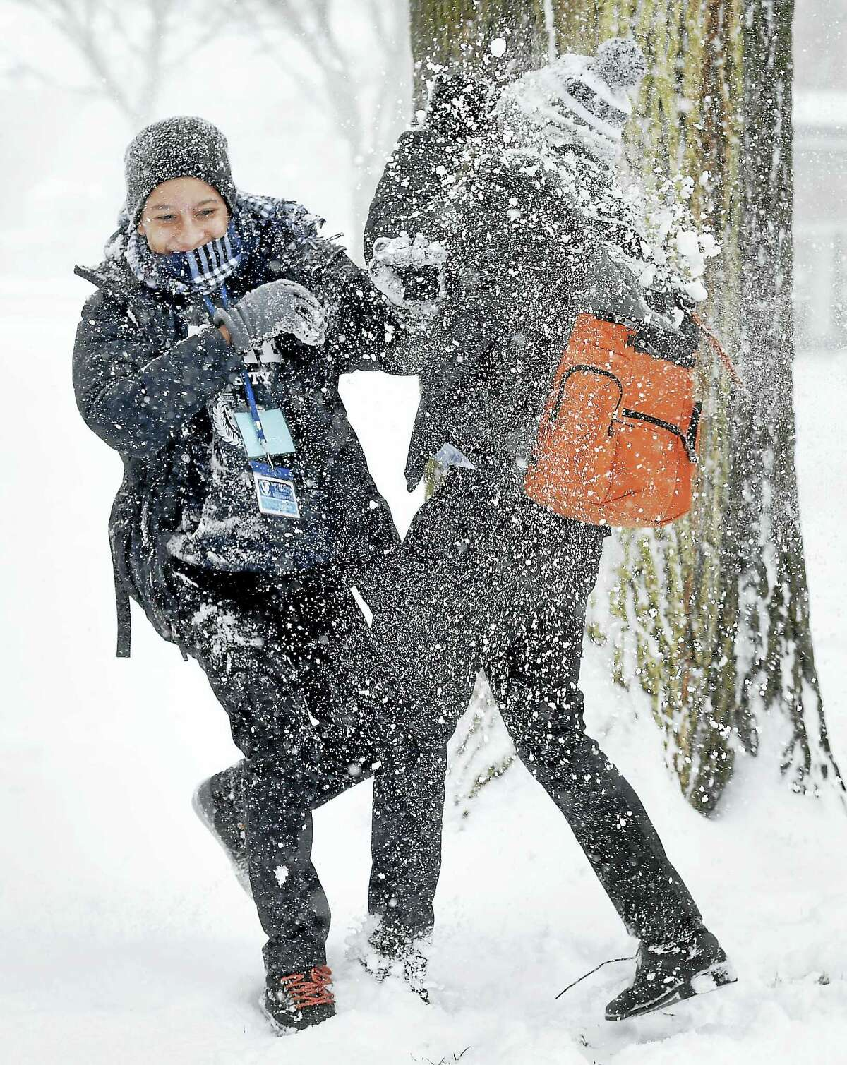 Victor Batista, left, and Joan Gomez have a snowball fight on Yale University's Cross Campus in New Haven in January.