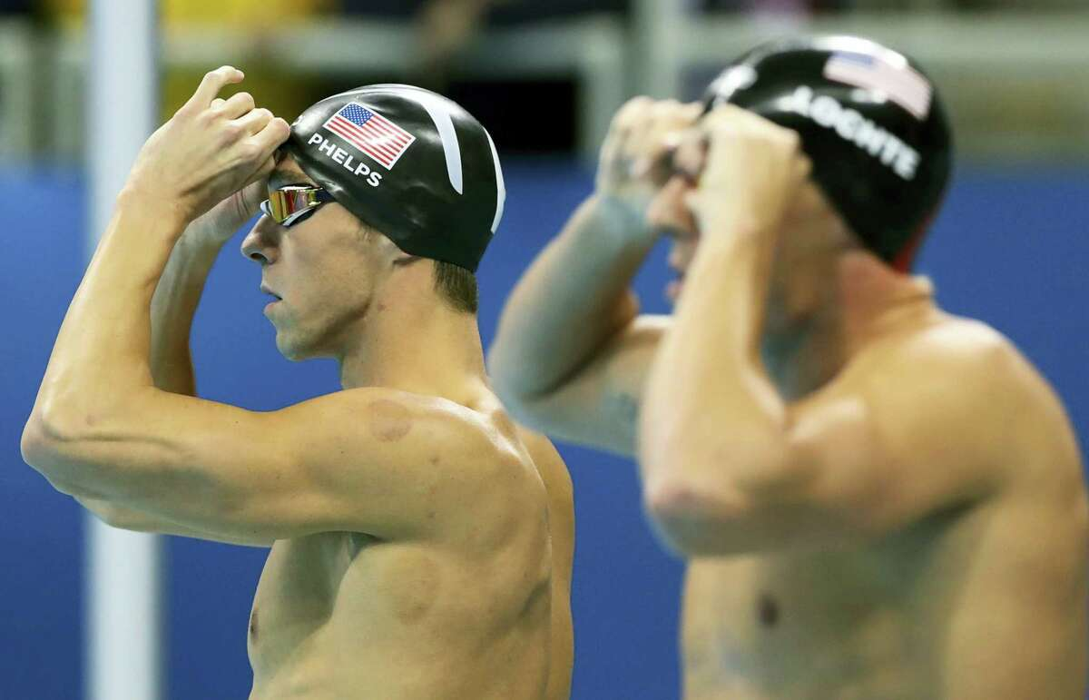 The United States' Michael Phelps, left, and Ryan Lochte prepare to compete in the final of the men's 200-meter individual medley during the swimming competitions at the 2016 Summer Olympics, Thursday in Rio de Janeiro.