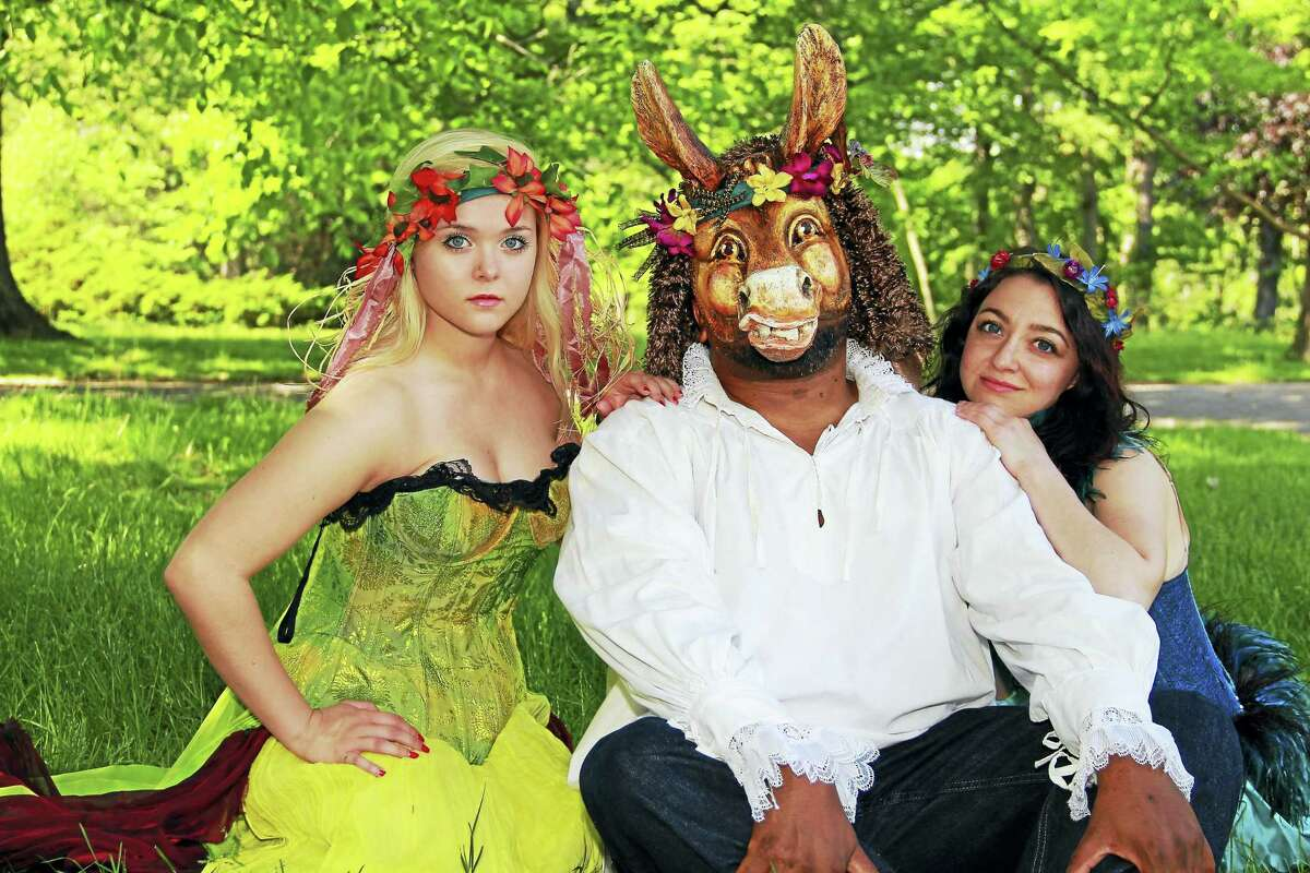 Raphael Massie, in mask, with Brianna Bauch and Elisa Albert at a photo shoot in the park.