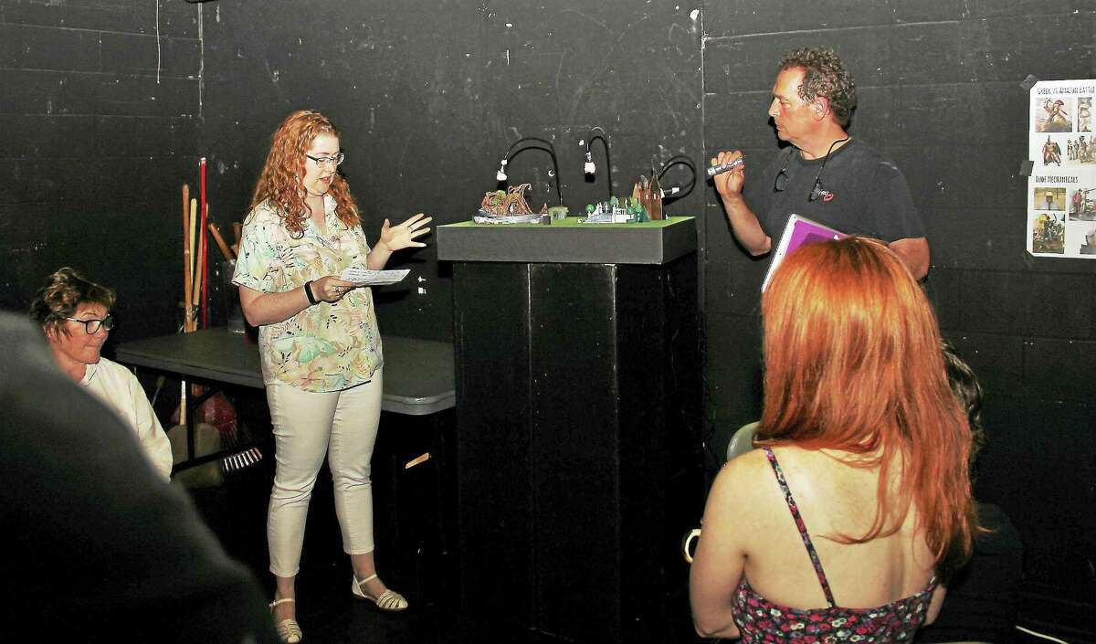 Elizabeth Bolster and Jamie Burnett talk about the set as Tina Packer, left, looks on.