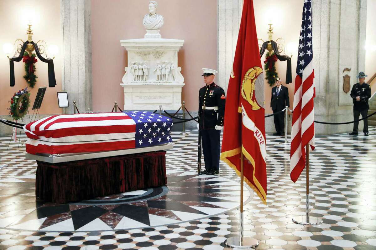 Marines stand guard at the casket of the John Glenn as he lies in repose, Friday, Dec. 16, 2016, in Columbus, Ohio. Glenn's home state and the nation began saying goodbye to the famed astronaut as he lies in state at Ohio's capitol building. Glenn, 95, the first American to orbit Earth, died last week.