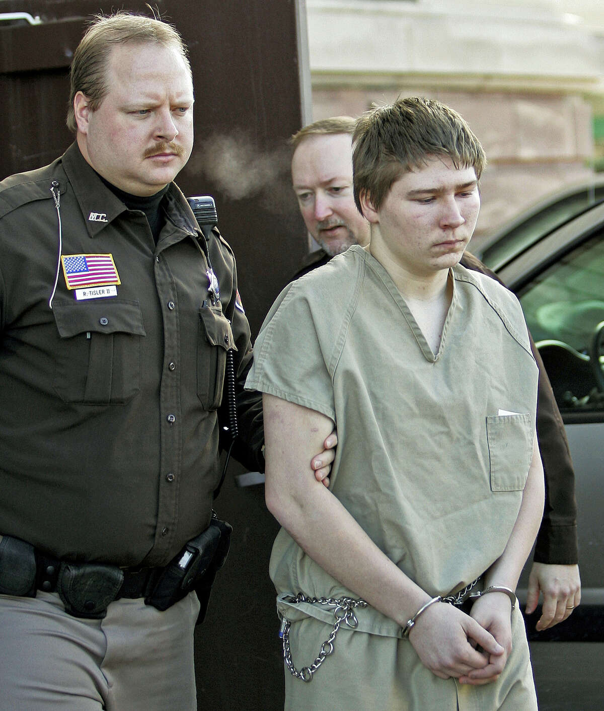 """Brendan Dassey, 16, is escorted out of a Manitowoc County Circuit courtroom in Manitowoc, Wis in 2006. A federal court in Wisconsin on Friday overturned the conviction of Dassey, a man found guilty of helping his uncle kill Teresa Halbach in a case profiled in the Netflix documentary """"Making a Murderer."""""""