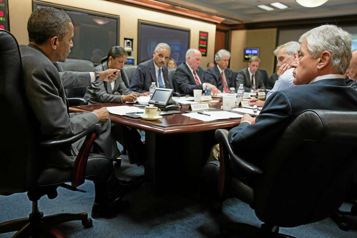 In this July 3, 2013, photo provided by the White House, President Barack Obama, left, meets with members of his national security team to discuss the situation in Egypt in the Situation Room of the White House in Washington.