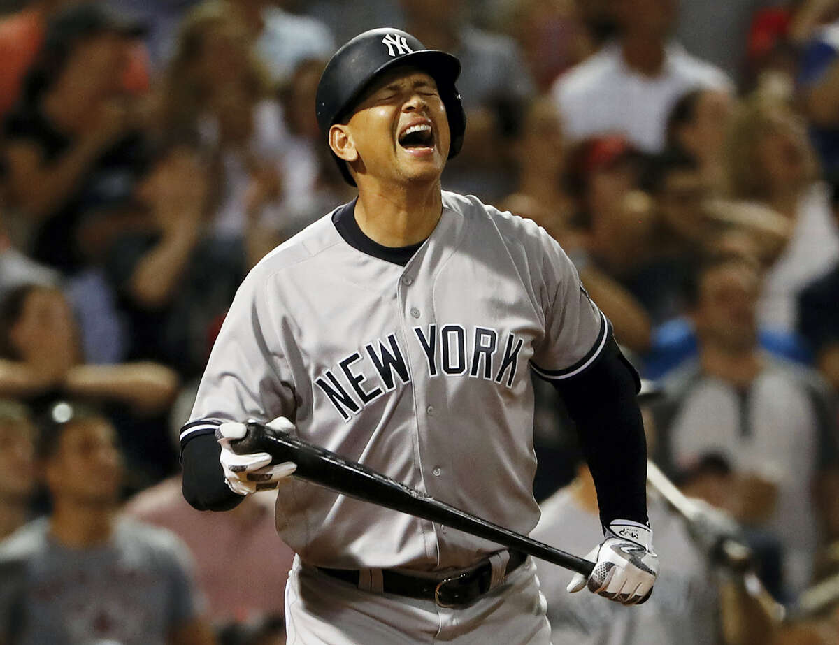 New York'S Alex Rodriguez reacts to flying out as a pinch hitter during the seventh inning against the Boston Red Sox at Fenway Park in Boston on Wednesday.