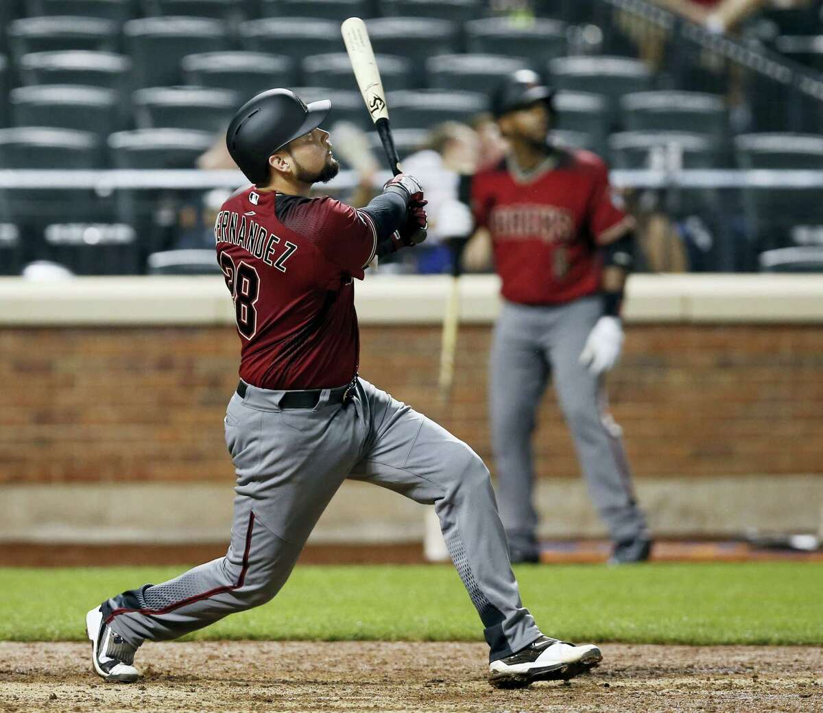 Arizona Diamondback Oscar Hernandez watches his 12th-inning solo home run off New York Mets relief pitcher Jerry Blevins. The Diamondbacks won 3-2.