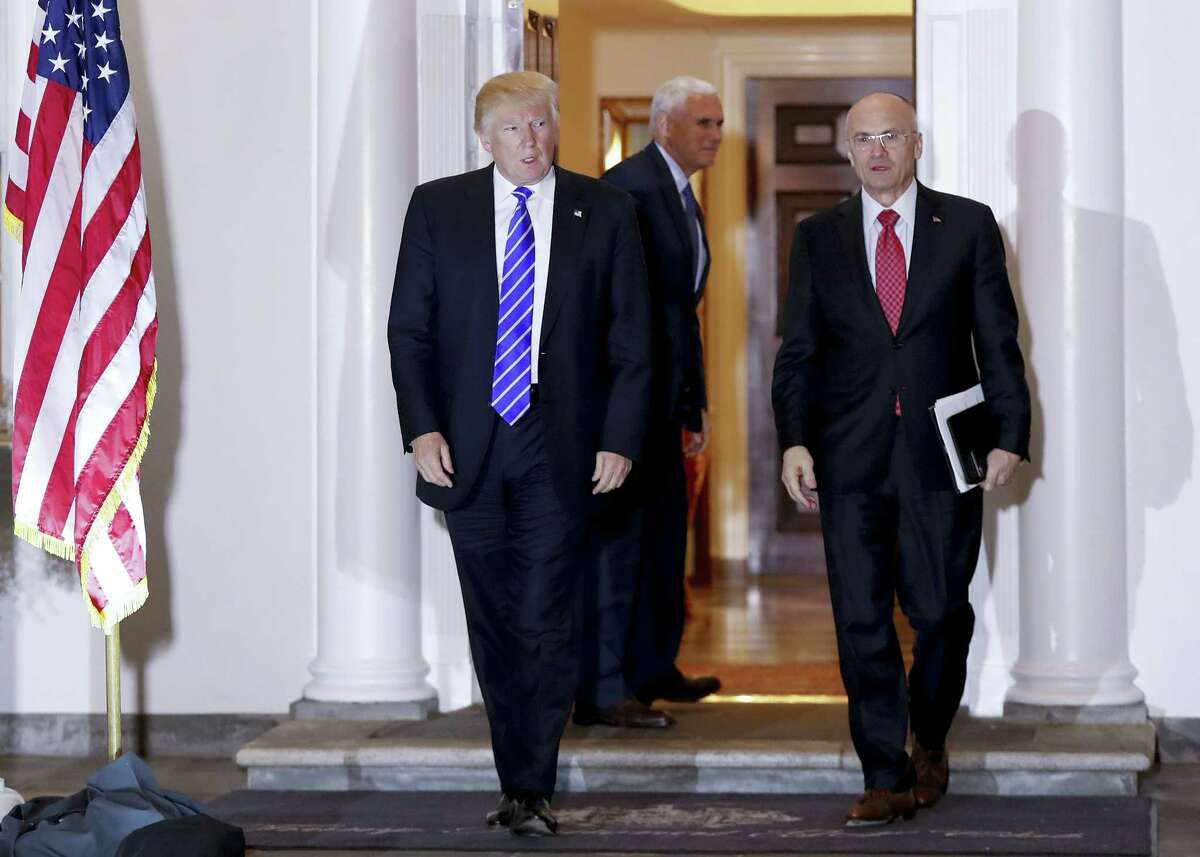 In this Nov. 19 file photo, President-elect Donald Trump walks Labor Secretary-designate Andy Puzder from Trump National Golf Club Bedminster clubhouse in Bedminster, N.J. Propelled by populist energy, President-elect Donald Trump's candidacy broke long-standing conventions and his incoming Cabinet embodies a sharp turn from the outgoing Obama administration.