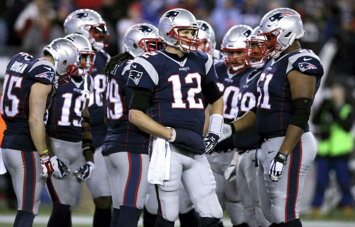 Patriots quarterback Tom Brady (12) waits for a play during a recent game.