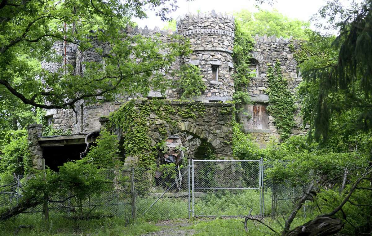Hearthstone Castle is overgrown with foliage in Danbury. The city is planning to demolish the castle, a landmark listed on the National Register of Historic Places, that was built in 1899 and has fallen into disrepair.