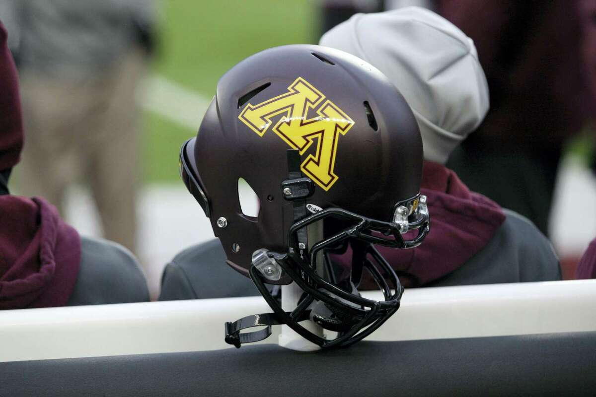 A Minnesota helmet hangs on a sideline heater during a recent game.