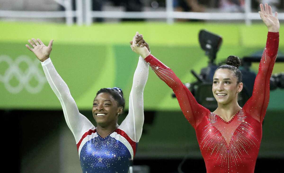 United States' Simone Biles, left, and Aly Raisman celebrate after winning gold and silver respectively for the artistic gymnastics women's individual all-around final at the 2016 Summer Olympics in Rio de Janeiro, Brazil, Thursday.