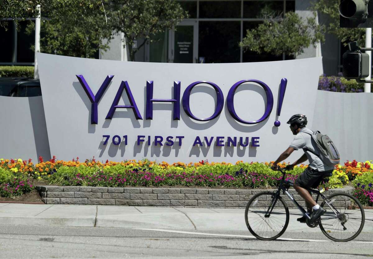 A cyclist rides past a Yahoo sign at the company's headquarters in Sunnyvale, Calif. The Yahoo hack announced Wednesday, Dec. 14, 2016 exposed personal details from more than 1 billion user accounts, potentially the largest breach of an email provider in history.