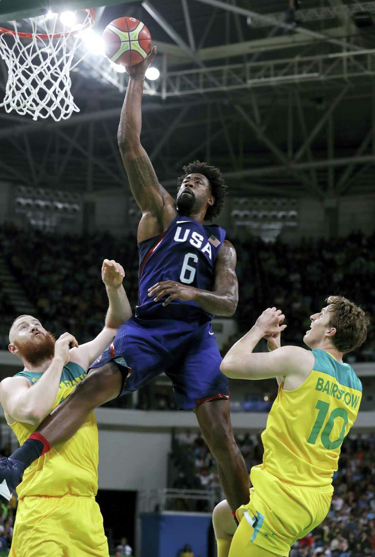 DeAndre Jordan (6) drives to the basket between Australia's Aron Baynes, left, and Cameron Bairstow during the 98-88 U.S. victory at the 2016 Summer Olympics in Rio de Janeiro, Brazil, Wednesday.