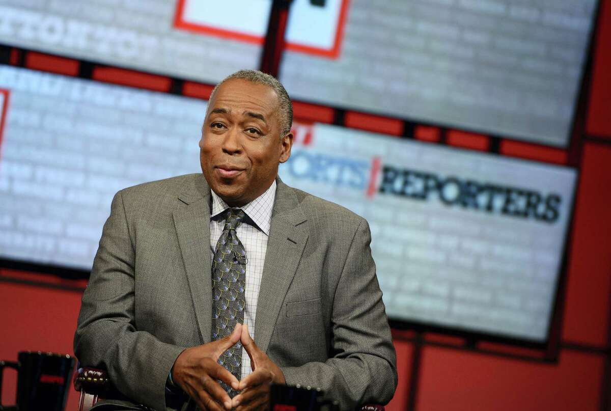"""In this May 12, 2013 photo provided by ESPN Images, John Saunders poses on the set of """"The Sports Reporters"""" in Studio A in Bristol, Conn. Saunders, who has hosted """"The Sports Reporters"""" for the last 15 years, has died, the ESPN announced Wednesday, Aug. 10, 2016. He was 61."""