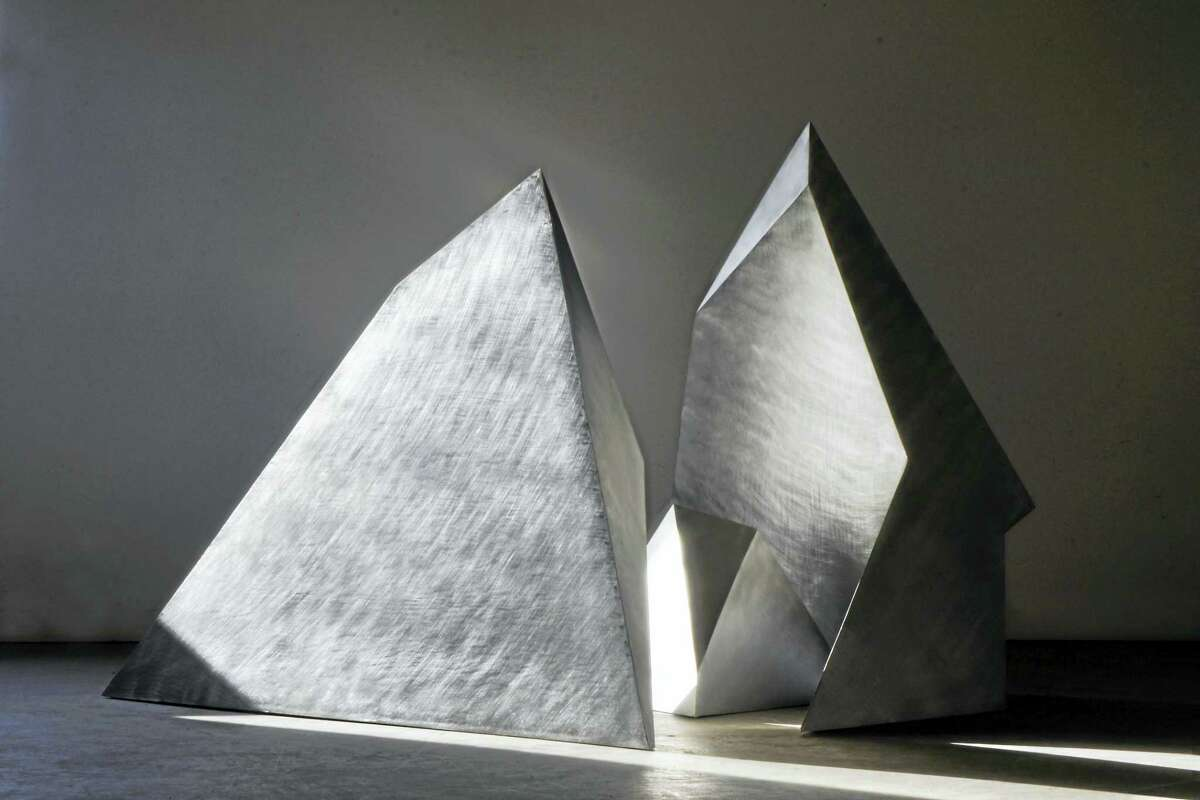 "Contributed photo courtesy of Five Points Gallery David Colbert: ""Fractured Tetrahedron (3 parts)"" 2015. Stainless Steel 30""x 48""x 24"" is part of the new exhibit opening Aug. 19 at Five Point Gallery in Torrington."