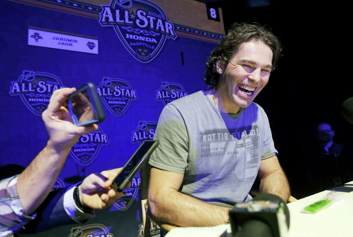 In this Jan. 29, 2016 photo, Florida Panthers forward Jaromir Jagr, of the Czech Republic, laughs as he talks with reporters at the NHL hockey All-Star game media day, in Nashville, Tenn. Jagr is closing in on become the second all-time leading scorer in NHL history. The 44-year-old Florida Panthers wing is within striking distance of passing Mark Messier, who had 1,887 points from 1979-2004.