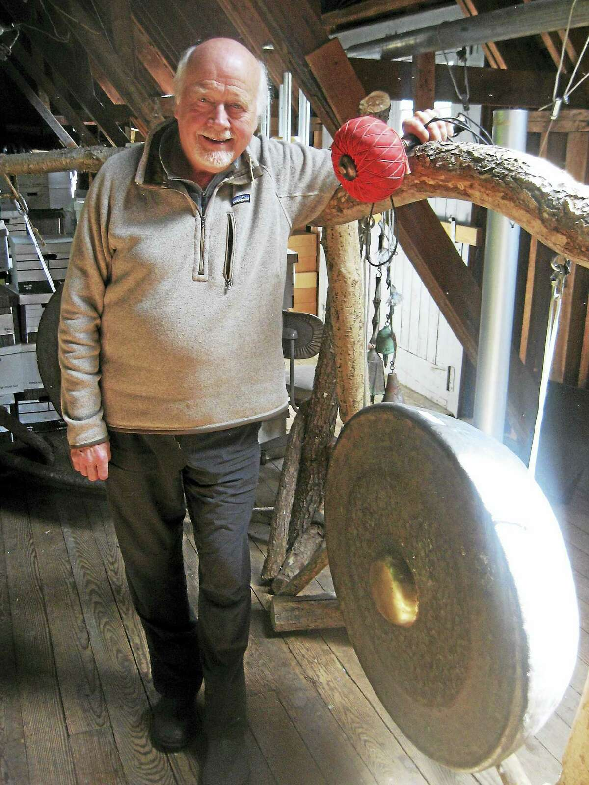 Photo by John TorsielloPaul Winter in his studio with a very large gong.