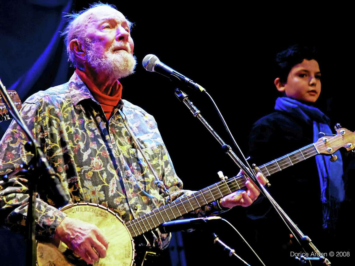 Dorice Arden photoPete Seeger plays the banjo in concert.