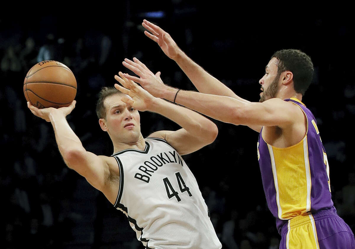 Brooklyn Nets' Bojan Bogdanovic (44) passes away from Los Angeles Lakers' Larry Nance Jr. (7) during the second half Wednesday in New York. The Nets won 107-97.