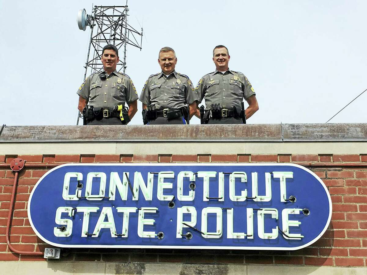 CONTRIBUTED PHOTO The building sign at the Troop B headquarters in North Canaan was recently restored. From left are Sgt Robert Janco, Troop B Commanding Officer; Lt. William Baldwin, Troop B Executive Officer; and Master Sgt. Michael O'Toole.