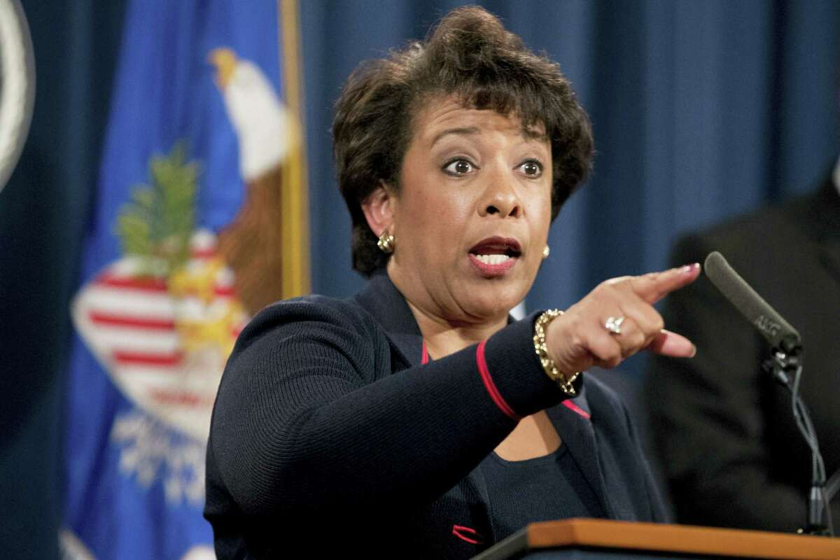 In this file photo Attorney General Loretta Lynch takes a question during a news conference at the Justice Department in Washington. Hate crimes tear at the fabric of American communities and represent a stain on the country's soul, Lynch said at a mosque and Muslim community center on Dec. 12. Lynch spoke at the All Dulles Area Muslim Society Center as law enforcement across the country confronts a spike in hate crimes targeting Muslims.