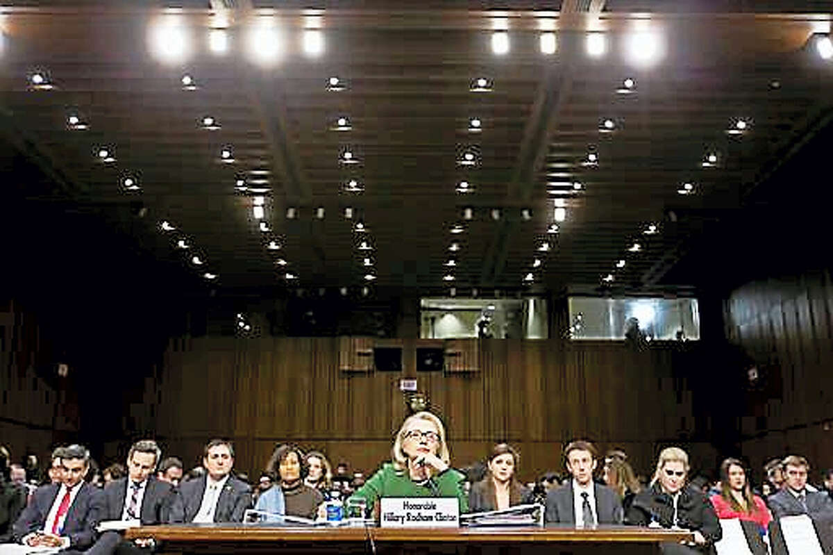 In this Wednesday, Jan. 23, 2013, file photo, Secretary of State Hillary Clinton testifies on Capitol Hill in Washington before the Senate Foreign Relations Committee hearing on the deadly September attack on the U.S. diplomatic mission in Benghazi, Libya, that killed Ambassador Chris Stevens and three other Americans.