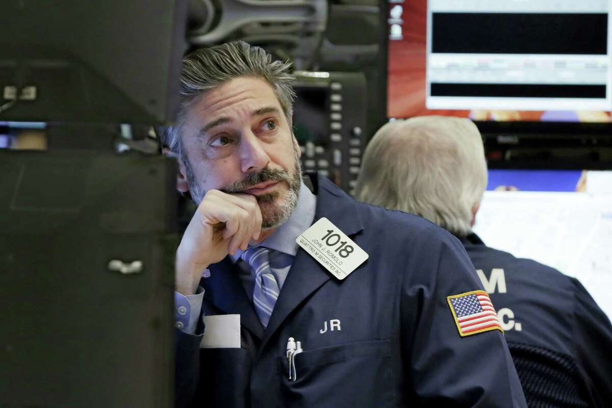 Trader John Romolo works on the floor of the New York Stock Exchange Wednesday.