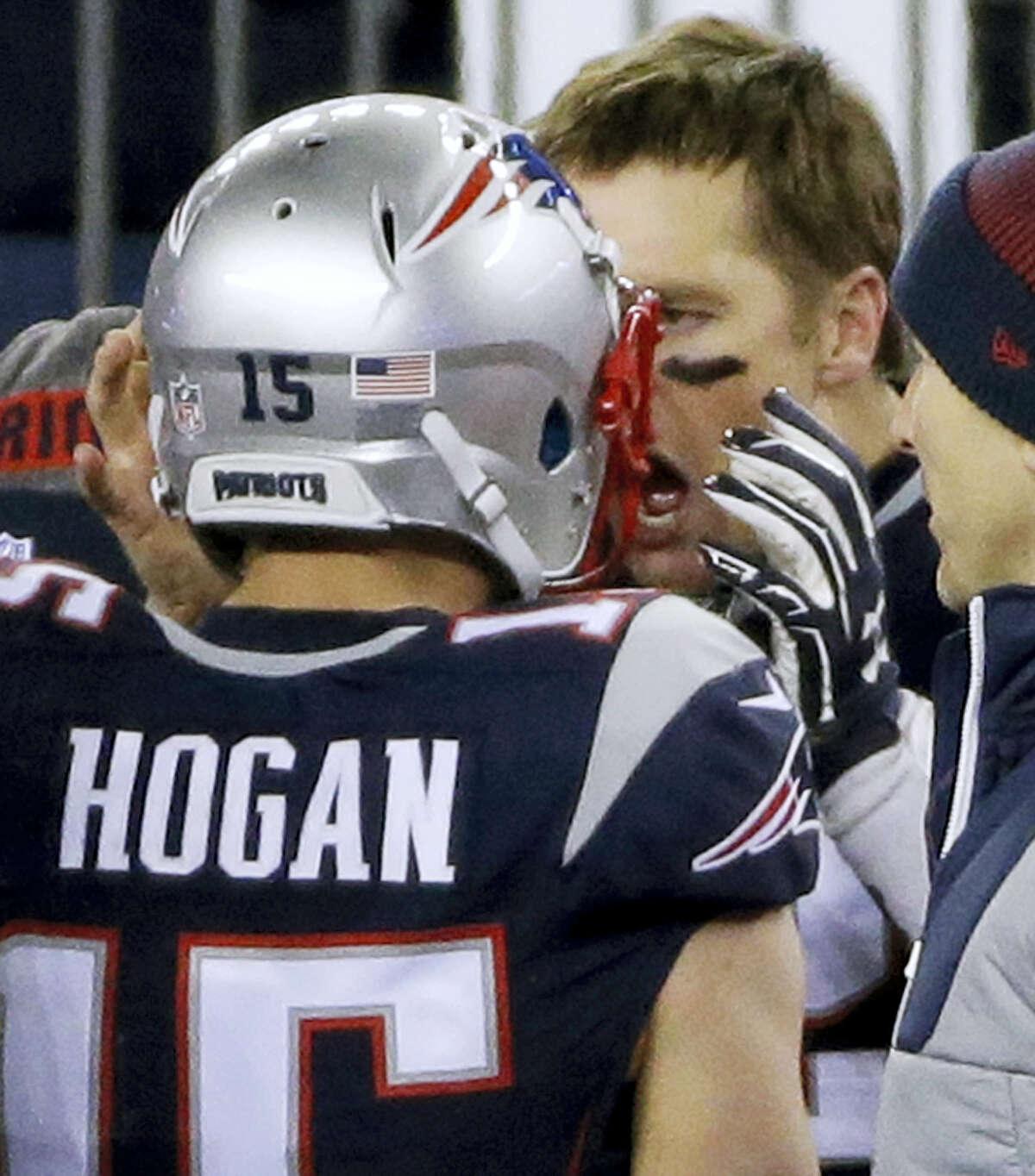 Patriots quarterback Tom Brady, right, celebrates his touchdown pass to Chris Hogan, left, during the fourth quarter Sunday night.