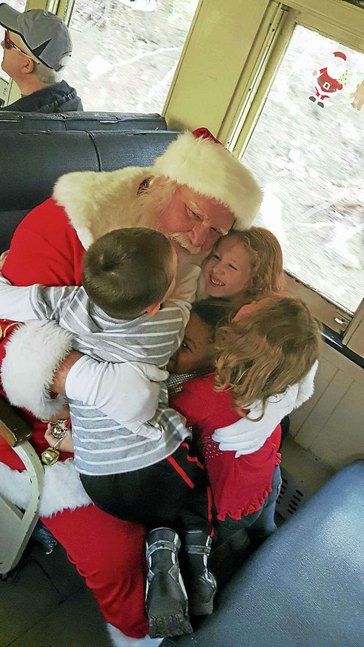 Photos by Heather StamppChildren hug Santa Claus during their train ride.