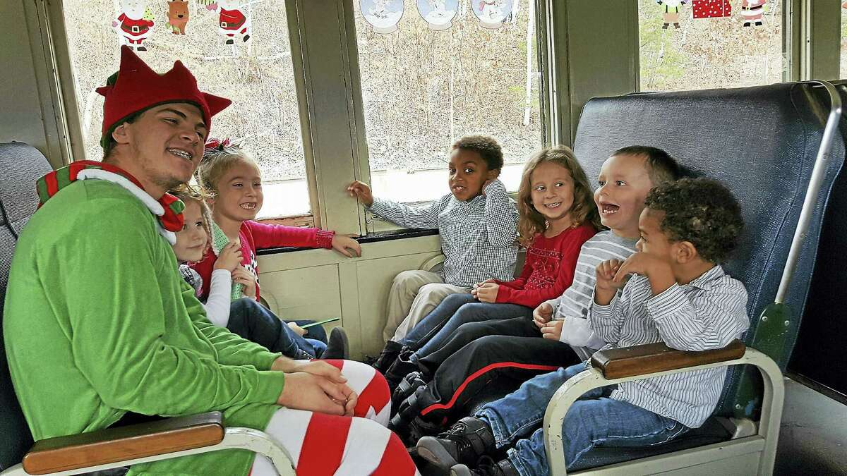 Photos by Heather StamppA group of happy children ride the train with an elf by their side.
