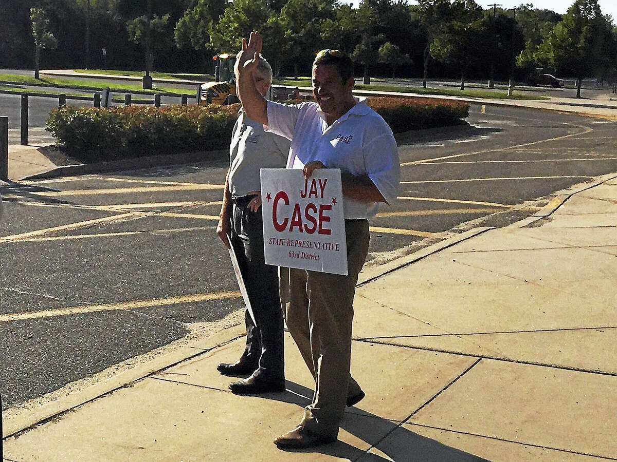 Ben Lambert - The Register CitizenJay Case waves to supporters Tuesday in Torrington.