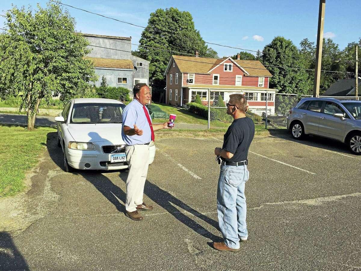 Ben Lambert - The Register CitizenDavid LaPointe talks to a prospective voter Tuesday.
