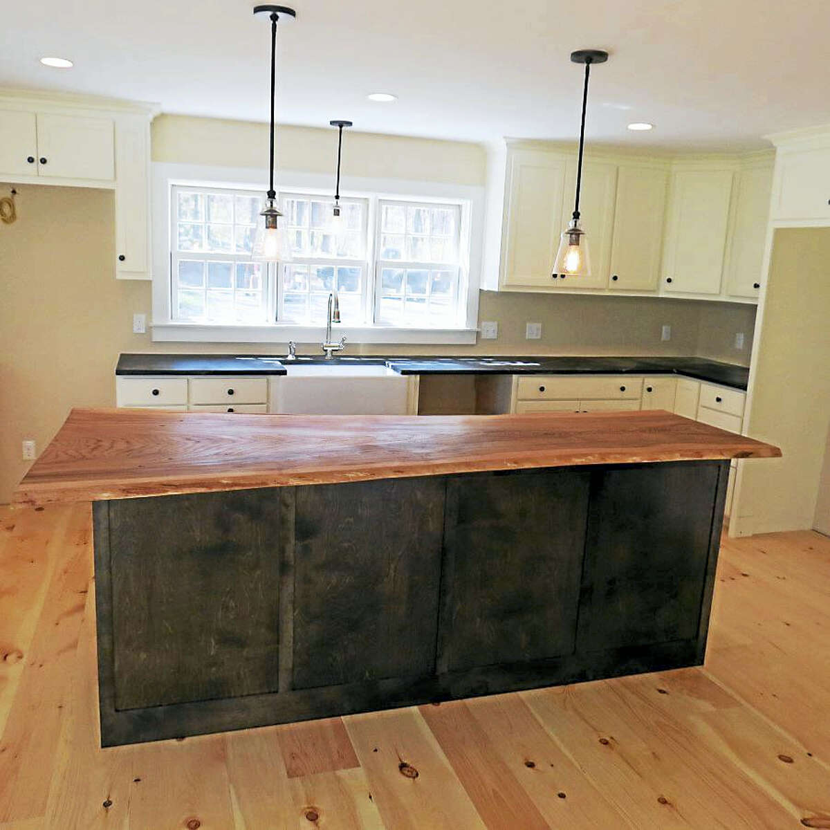 An English elm island graces the newly renovated kitchen.