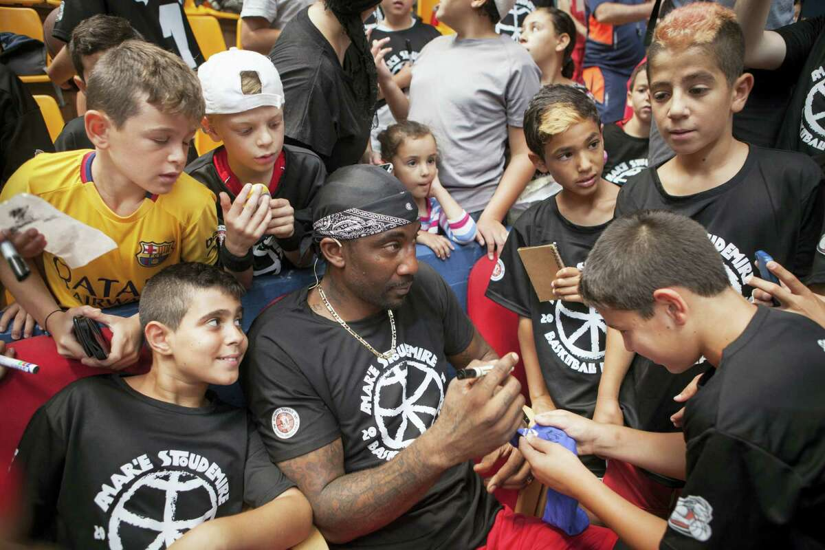 Recently retired NBA star Amare Stoudemire signs autographs in Jerusalem, Monday. Stoudemire signed a two-year contract to play for Israeli team Hapoel Jerusalem.