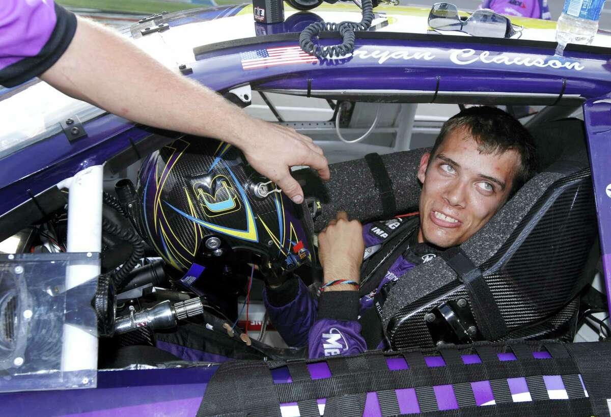 In this file photo, Bryan Clauson smiles in his car during qualifying for the ARCA RE/MAX Series 250 at Talladega Superspeedway in Talladega, Ala. Clauson, considered the top dirt-track racer in the country, has died from injuries suffered in an accident at the Belleville (Kansas) Midget Nationals USAC midget race. He was 27. His death was announced Monday morning at Indianapolis Motor Speedway.