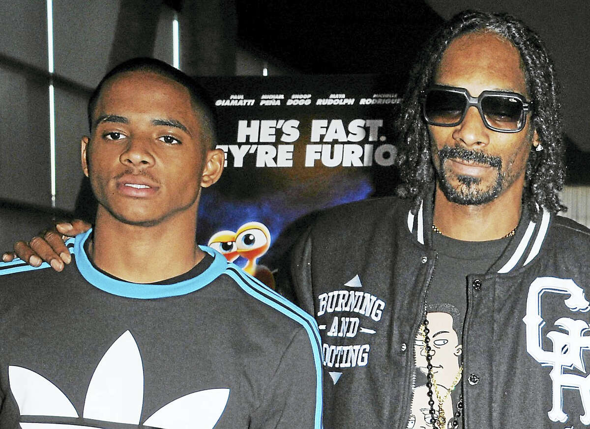 Snoop Dogg, right, poses with his son, Cordell Broadus in 2013.