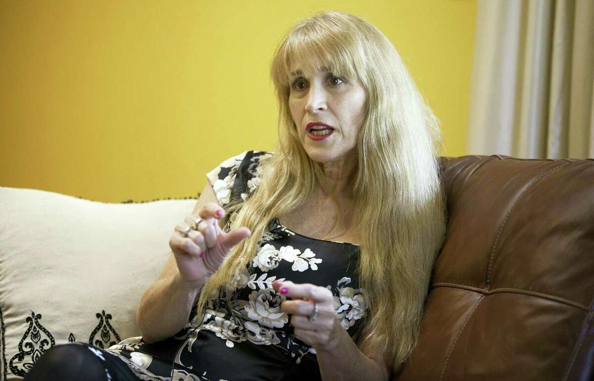 FILE – In this Nov. 20, 2014, file photo, nurse Therese Serignese, who says comedian Bill Cosby raped her following a 1976 show in Las Vegas when she was 19 years old, discusses her allegations at her home in Boca Raton, Fla. Lawyers for Cosby will battle in court in Norristown, Pa., Tuesday, Dec. 13, 2016 to try to limit the number of other accusers who can testify at the comedian's sexual assault trial. The Associated Press does not typically name people who say they are sexual assault victims, but Therese Serignese has spoken out publicly. (AP Photo/J Pat Carter, File)