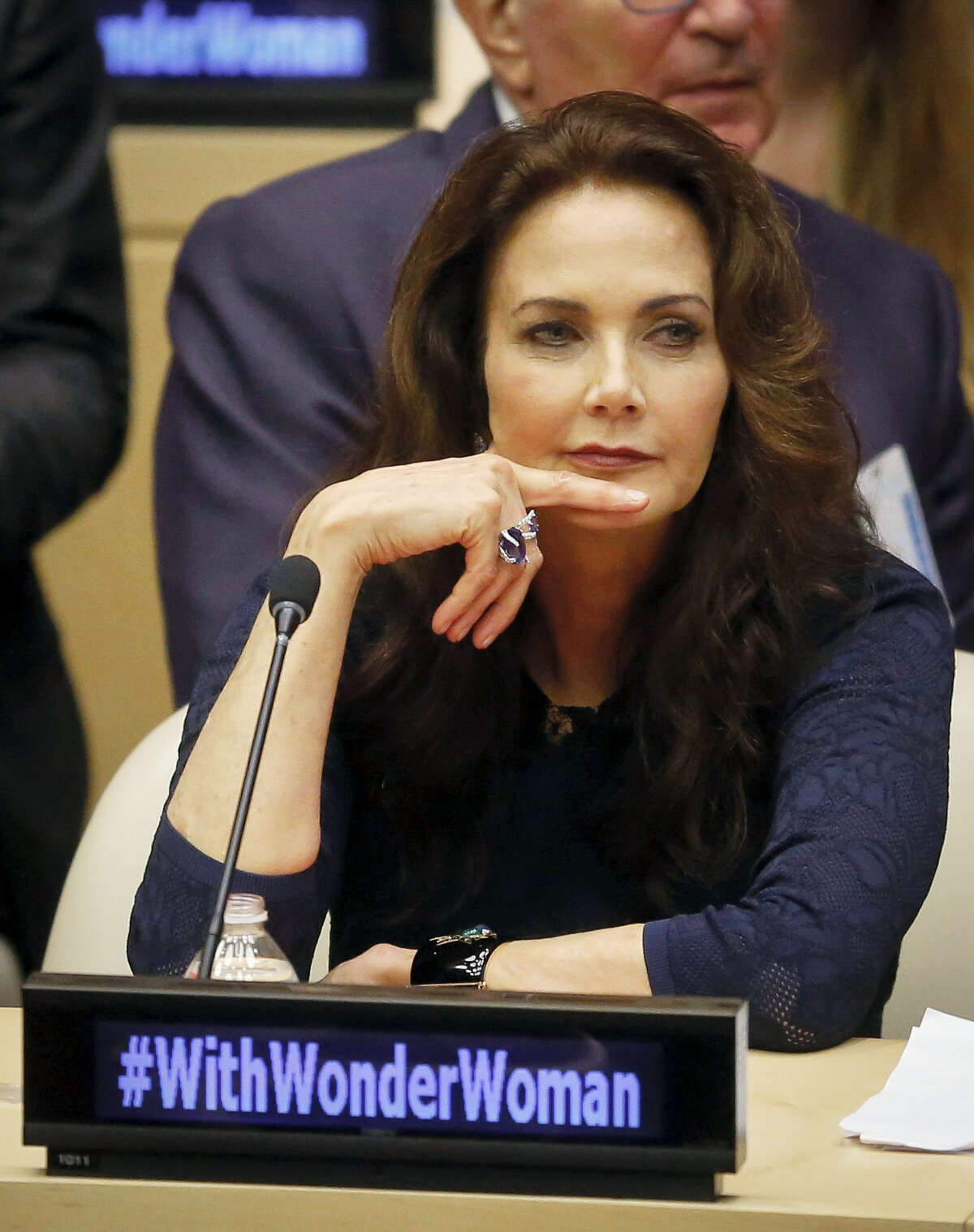 """In this Oct. 21, 2016 photo, Lynda Carter, who played Wonder Woman on television, listens during a U.N. meeting to designate Wonder Woman as an """"Honorary Ambassador for the Empowerment of Women and Girls,"""" at U.N. headquarters. Rhéal LeBlanc, the head of press and external relations, said Tuesday, Dec. 13, 2016 the appointment of Wonder Woman as an Honorary Ambassador for the Empowerment of Woman and Girls would end this week, a move that comes less than two months after a splashy ceremony at the U.N."""
