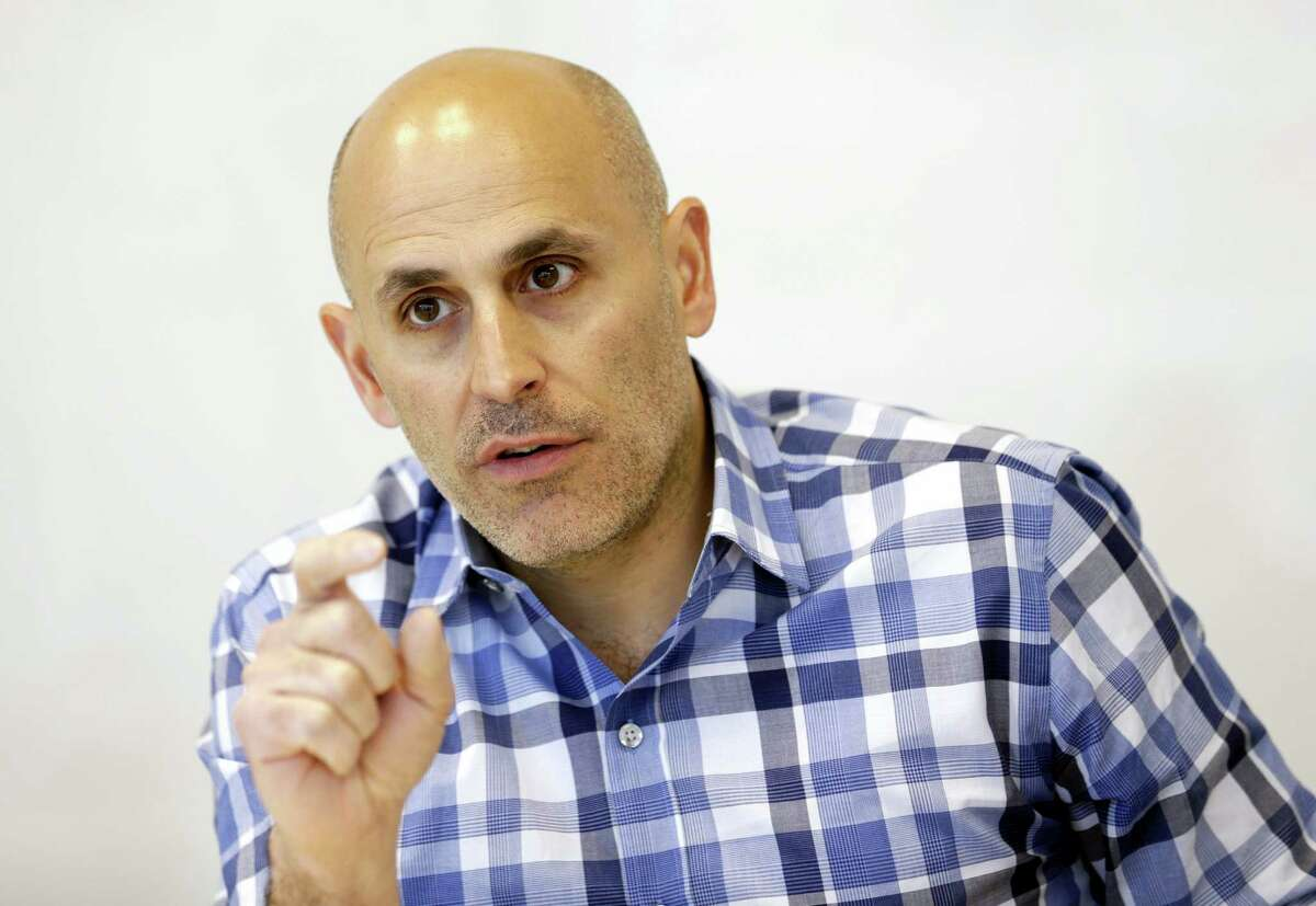 In this May 2, 2016 photo, Jet.com CEO Marc Lore speaks during an interview in Hoboken, N.J. Wal-Mart announced Monday, Aug. 8, 2016, that the company has agreed to buy fast-growing online retail newcomer Jet.com, which had launched with a splash in 2015 when it announced its intention to challenge online leader Amazon.
