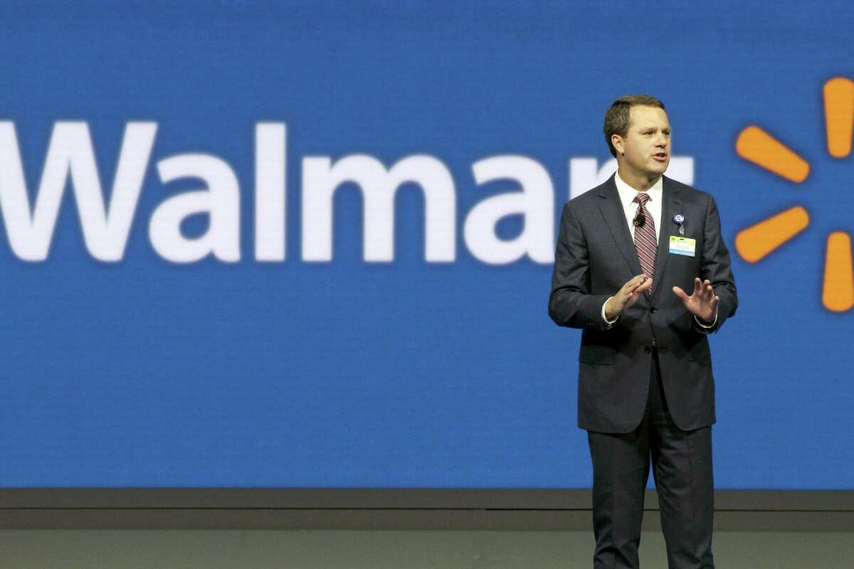 FILE - In this Friday, June 5, 2015, file photo, Wal-Mart Chief Executive Officer Doug McMillon speaks at the company's shareholder meeting in Fayetteville, Ark. Wal-Mart announced Monday, Aug. 8, 2016, that the company has agreed to buy fast-growing online retail newcomer Jet.com, which had launched with a splash in 2015 when it announced its intention to challenge online leader Amazon. The deal underscores how serious Wal-Mart is about igniting its online business, which has been slowing even as it has been making big investments in new distribution centers and expanding services. (AP Photo/Danny Johnston, File)