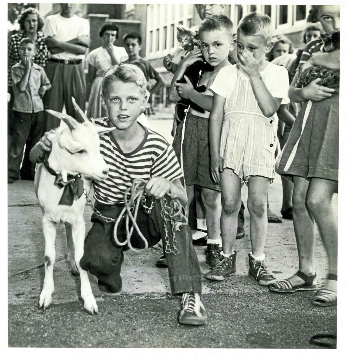 Photo courtesy of the Torrington Historical Society ArchivesBobby Martinotti and his pet goat, winner of Torrington Park and Rec Department's pet contest at Southwest School in the 1940s, is one of the photographs featured in the society's new exhibit, Pet Pals, which opens Thursday. The exhibit also features a collection of photos contributed by members of today's Torrington community.