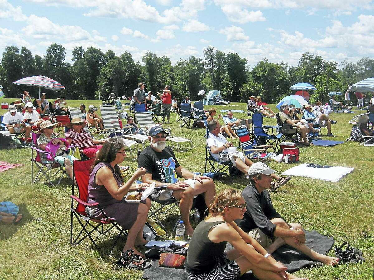 Photo by John TorsielloFestivalgoers lounge outside the main tent at the Litchfield Jazz Festival.