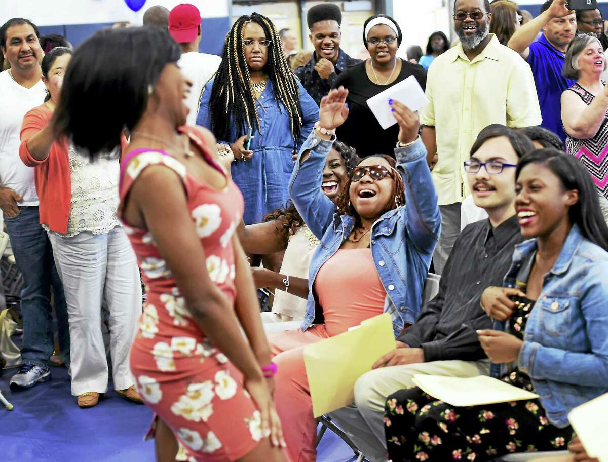 Mercedes Alexander of New Haven, an Achievement First Amistad High School senior, celebrates fellow students during a ceremony May 26 when students announced their college choices.