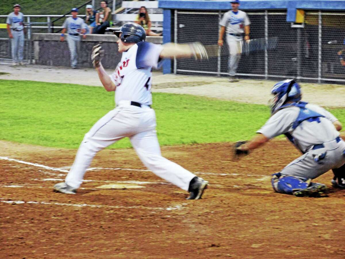 Photo by Peter WallaceTorrington's Mike Foley batted in three runs in the Titans' playoff-clinching win over the Bristol Blues Saturday night at Fuessenich Park.