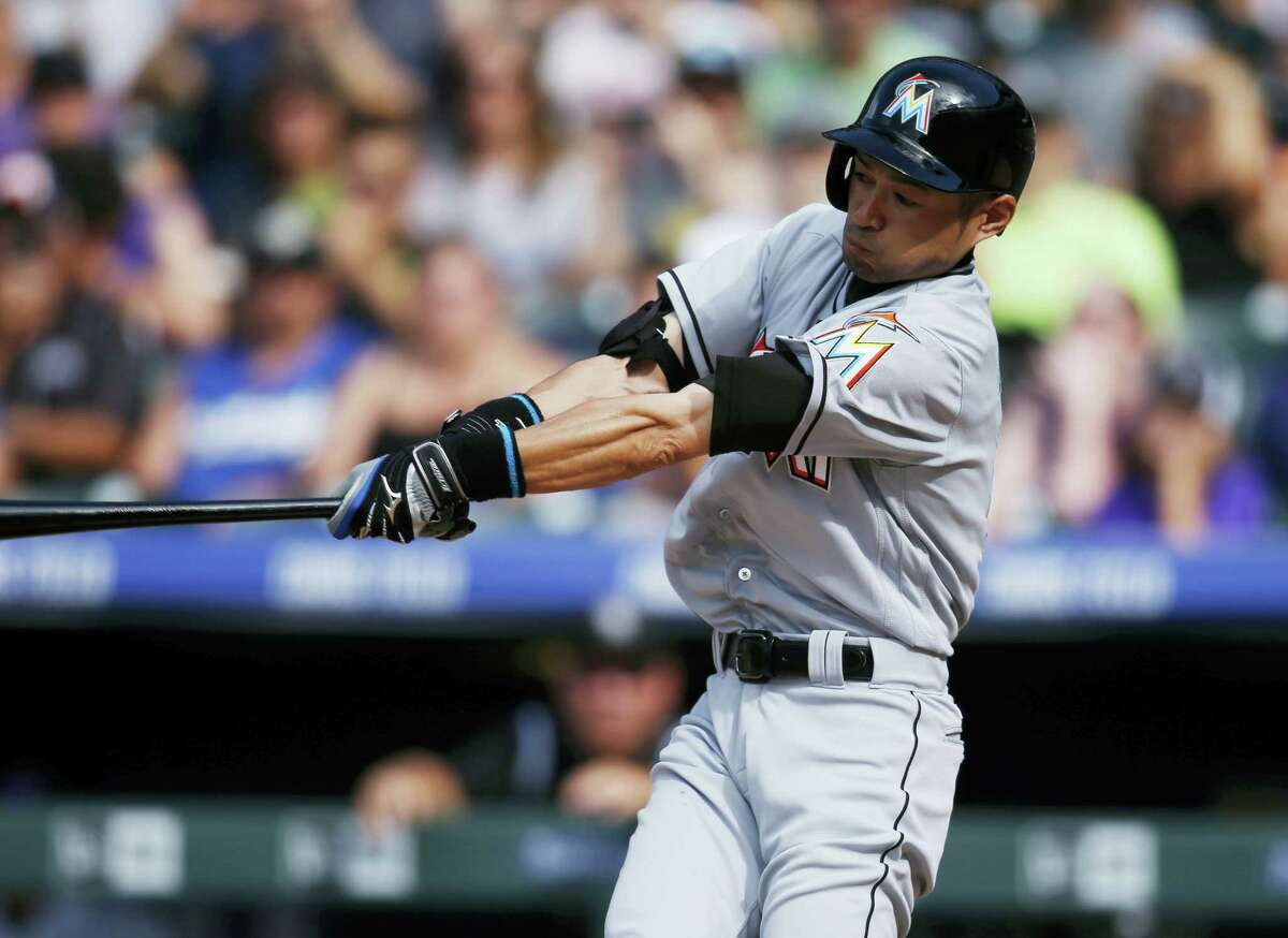 The Marlins' Ichiro Suzuki connects for a triple in the seventh inning on Sunday. It was his 3,000th career hit in the major leagues.