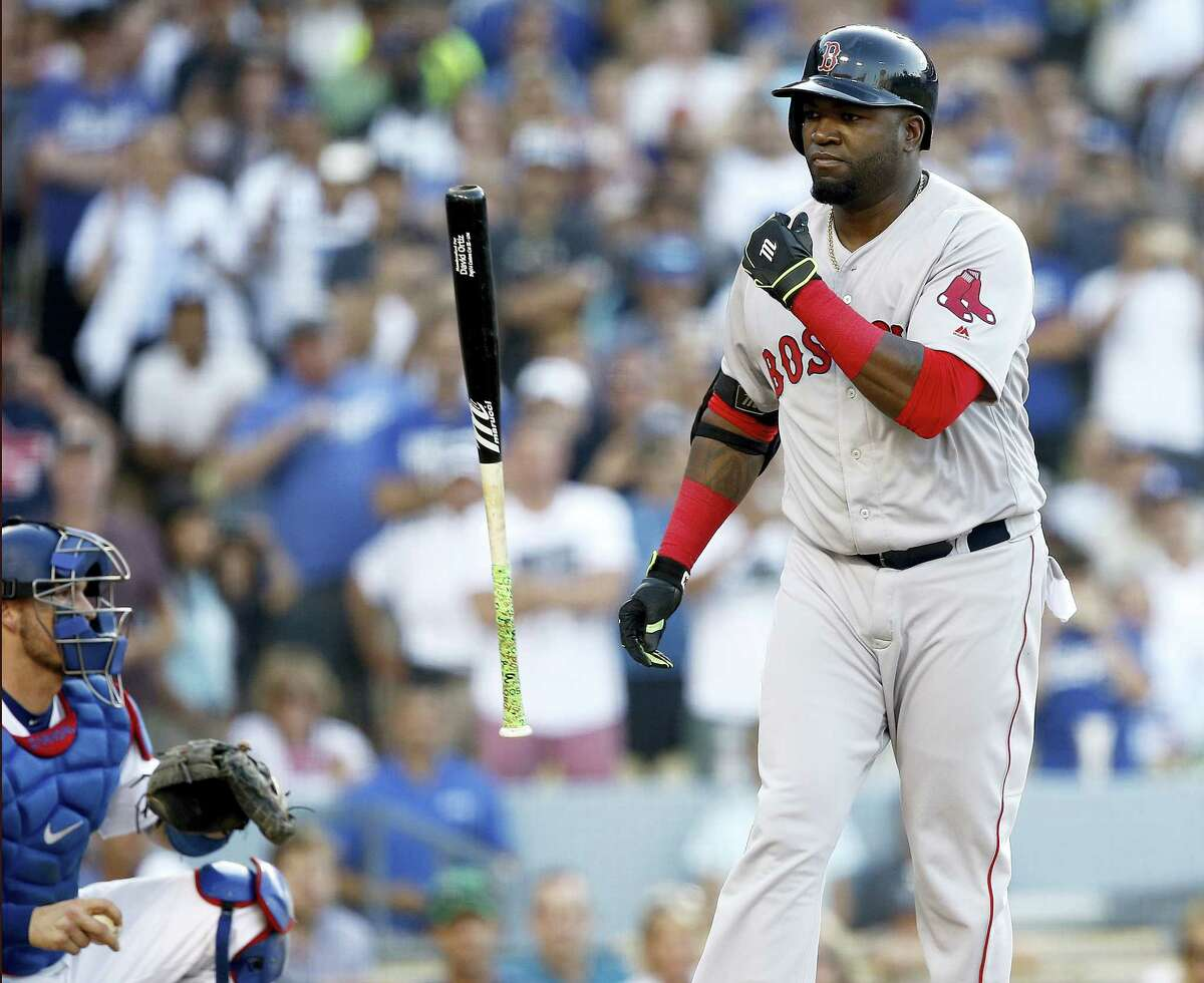 David Ortiz, right, reacts after being intentionally walked during Sunday's game.