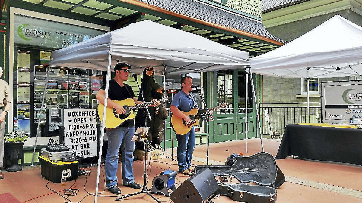 """N.F. Ambery photo Brandt Taylor and Tyler Coleman perform medleys of classic rock songs in front of Infinity Music Hall in Norfolk Sunday afternoon during the town's """"A Weekend in Norfolk"""" event."""