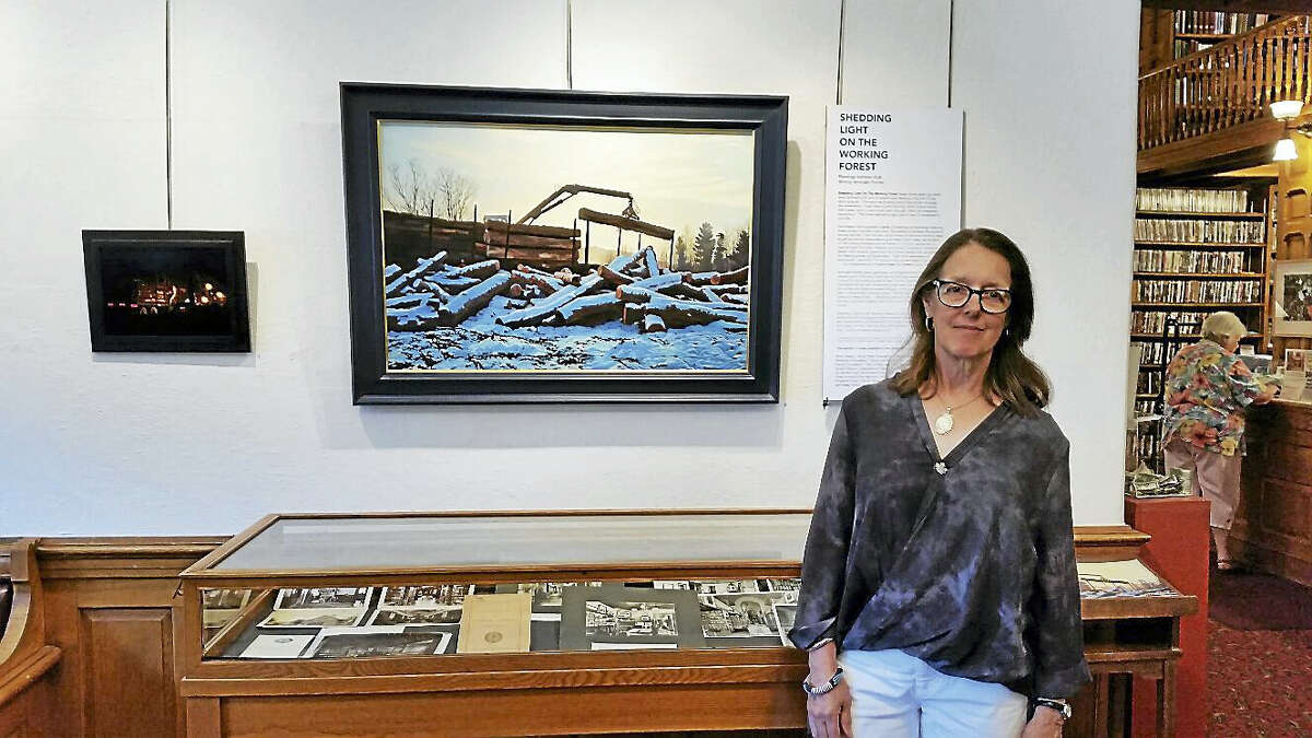 """N.F. Ambery photo Kathleen Kolb of Vermont with items from her one-woman art show """"Shedding Light on the Working Forest"""" at the Norfolk Library at 9 Greenwoods Road East."""