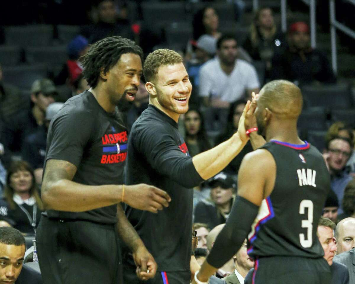 Los Angeles Clippers center DeAndre Jordan, forward Blake Griffin (#32) and guard Chris Paul (#3) in an NBA basketball game between Los Angeles Clippers and New Orleans Pelicans on Dec. 10, 2016 in Los Angeles.