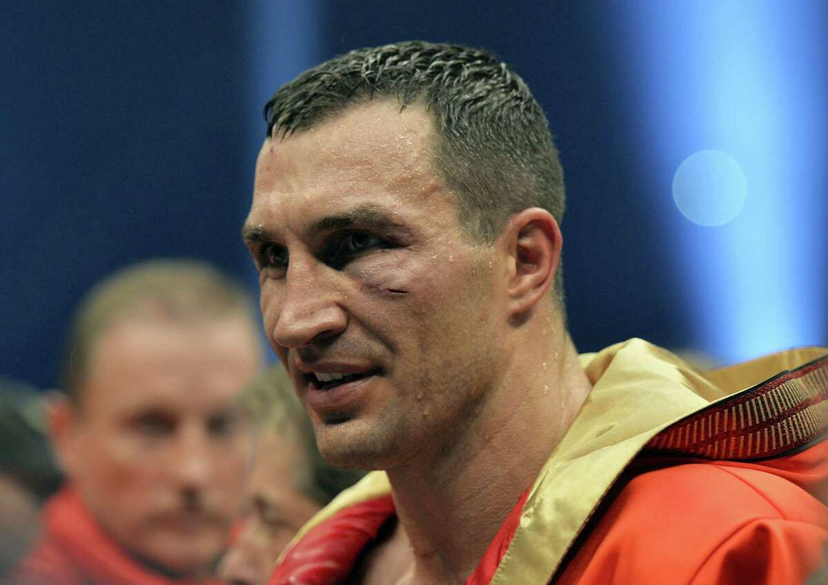 Ukraine's Wladimir Klitschko sports cuts in his face after losing to Britain's Tyson Fury in a world heavyweight title fight for Klitschko's WBA, IBF, WBO and IBO belts in the Esprit Arena in Duesseldorf, western Germany on Nov. 29, 2015.